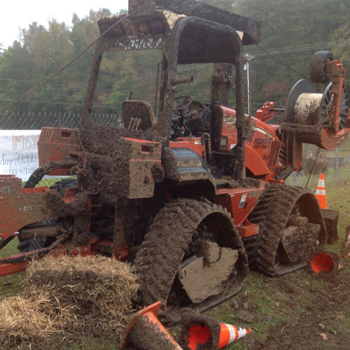 Cable Plow Covered in Mud