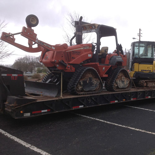 Plow loaded on trailer